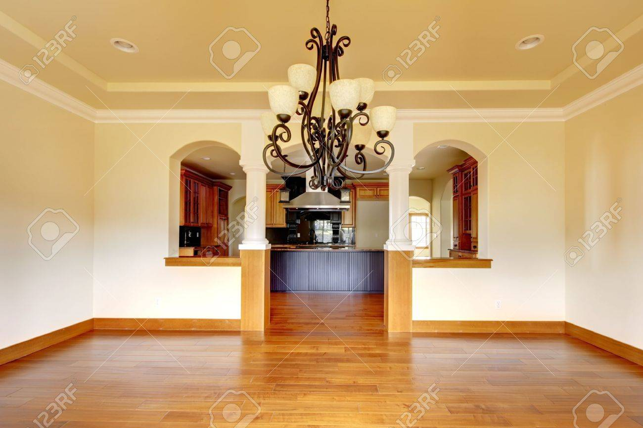 Large luxury dining room interior with kitchen and arch new empty home stock photo