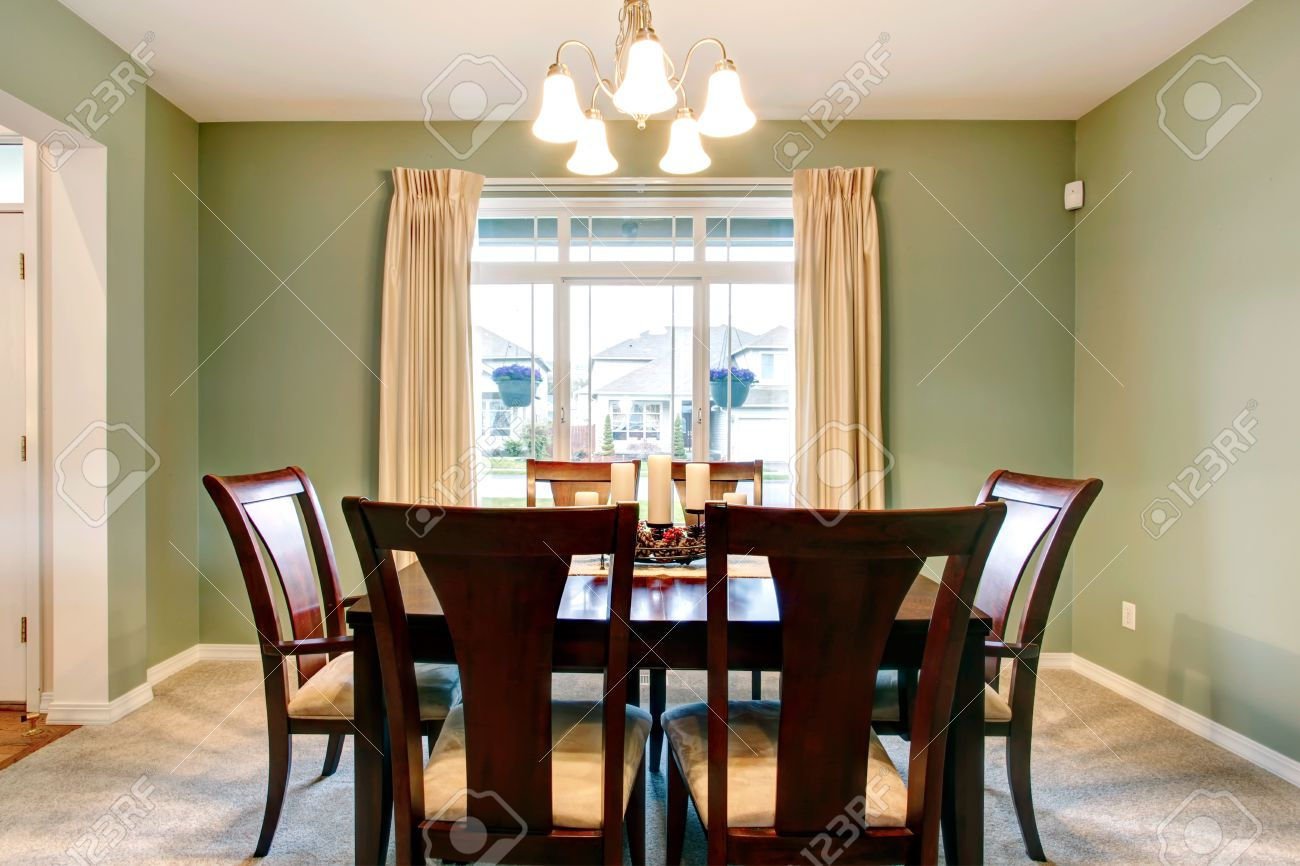 Green Dining Room Interior With Classic Brown Furniture And Beige