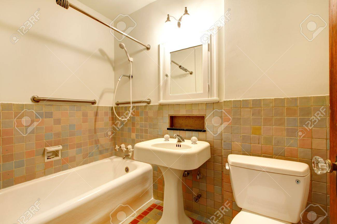Apartment Bathroom With Old Antique Fixtures And White Tub. Stock ...