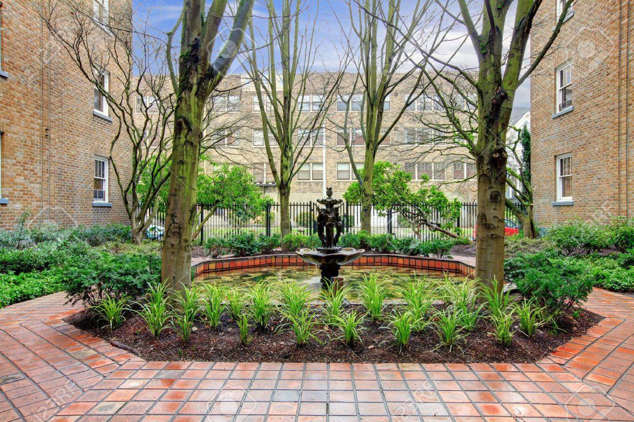 City Apartment Building Main Front Yard With Spring Landscape