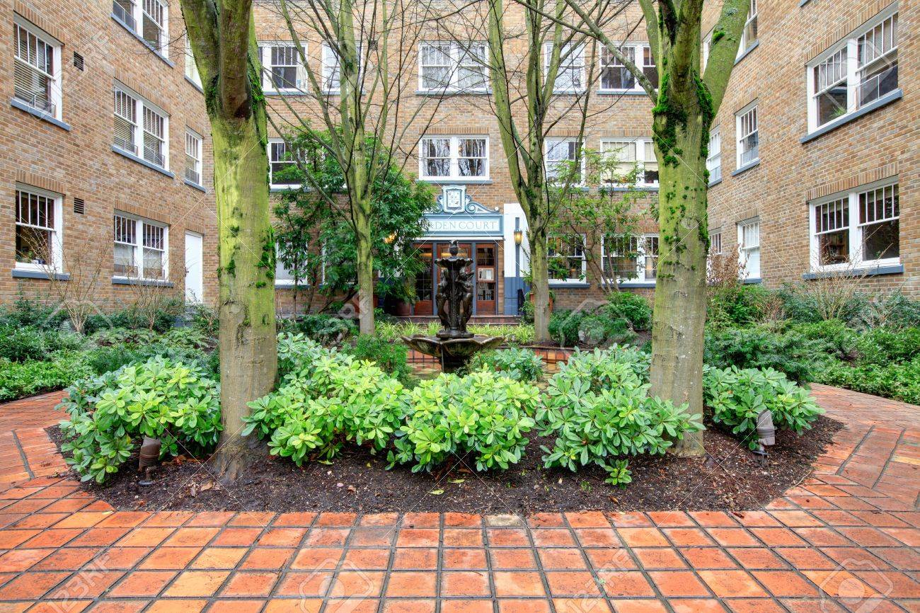 Apartment Building Front city apartment building main front yard with spring landscape