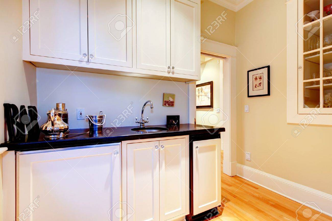 White cabinets of space between kitchen and dindng room - serving room. Stock Photo - 20992961