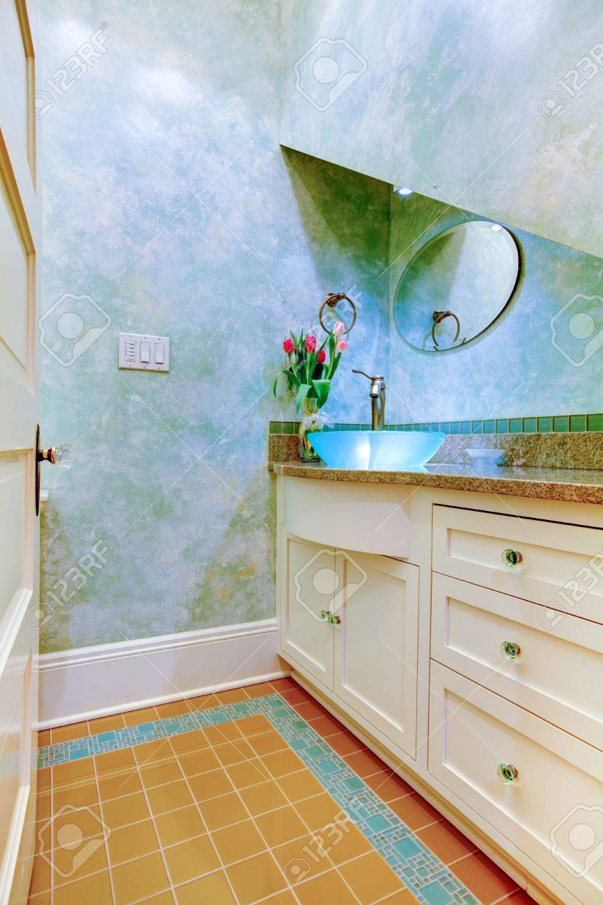 Small beautiful blue bathroom, powder room with blue sink and white cabinets. Stock Photo - 20992967