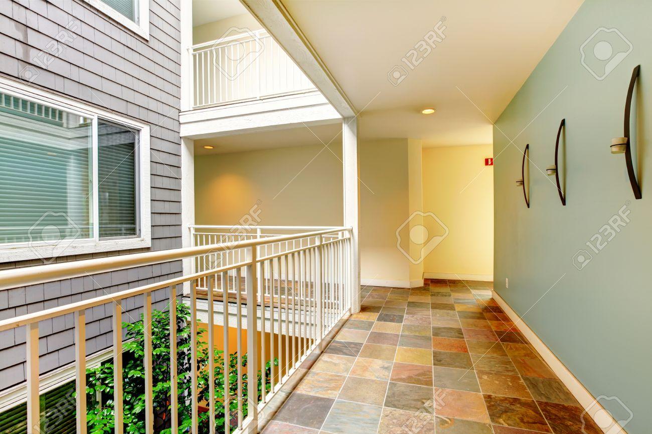 Apartment Building Hallway modern apartment building hallway and door near railing. stock