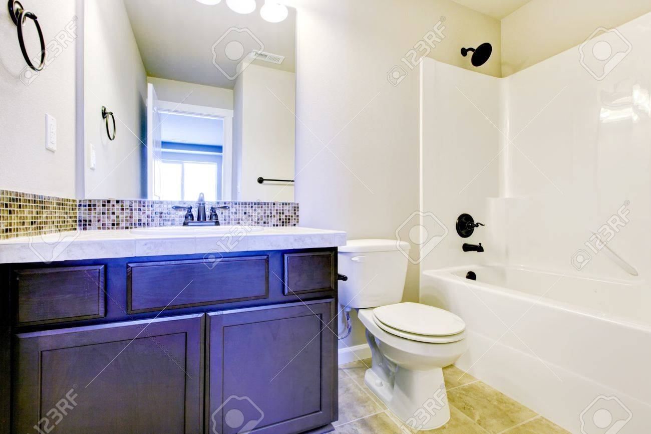 New Home Bathroom Interior With Shower And Bath Combination,.. Stock ...
