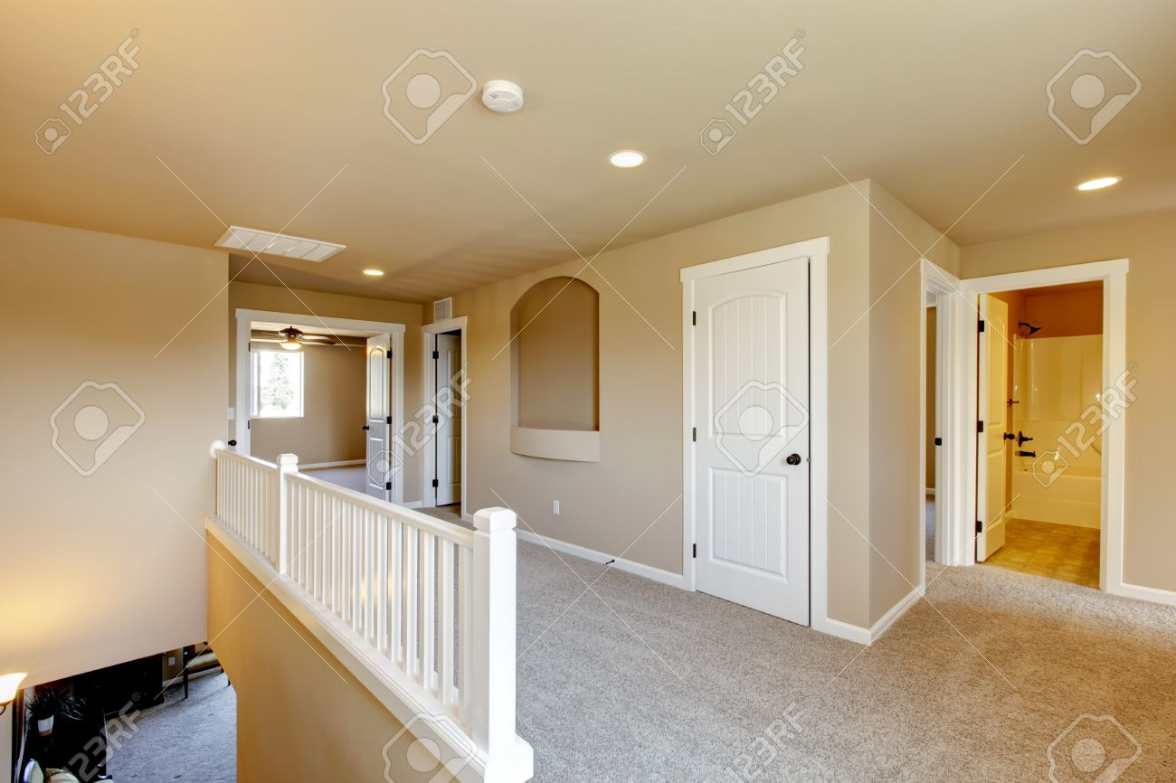 New empty room with beige carpet   New house development in USA Stock Photo - 21728925
