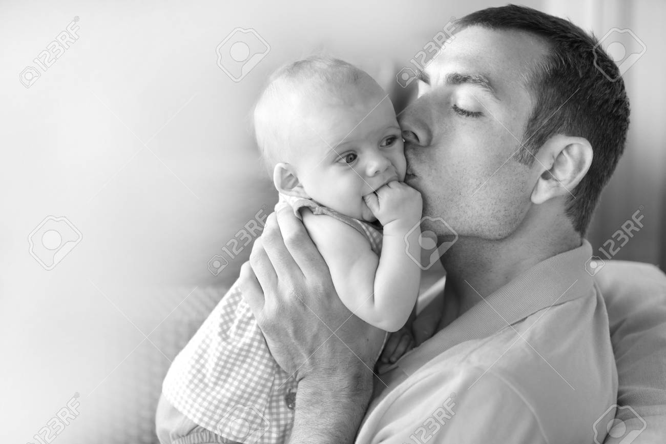 Young father is holding baby girl. Stock Photo - 21573735