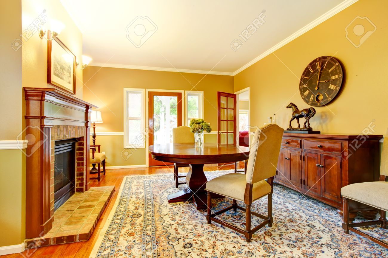 LIving Room With Fireplace, Mustard Wall Color And Beautiful.. Stock ...