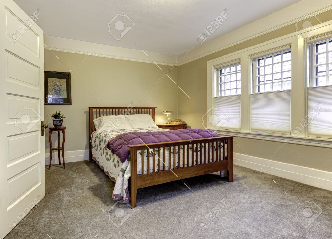 Classic Bedroom With Brown Queen Size Bed, Beige Walls And White ...