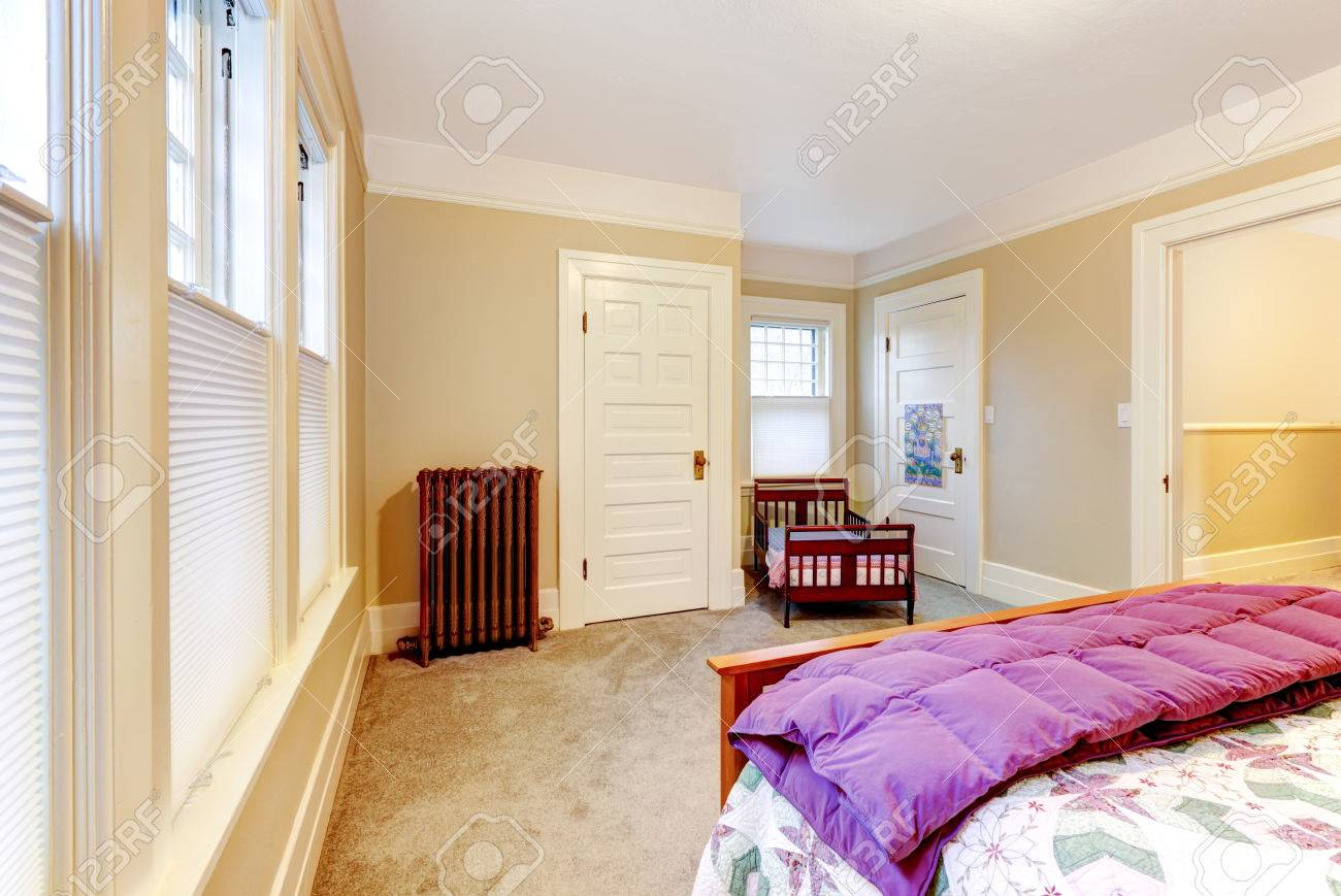 Classic Bedroom With Brown Meduim Size Bed, Beige Walls And White ...