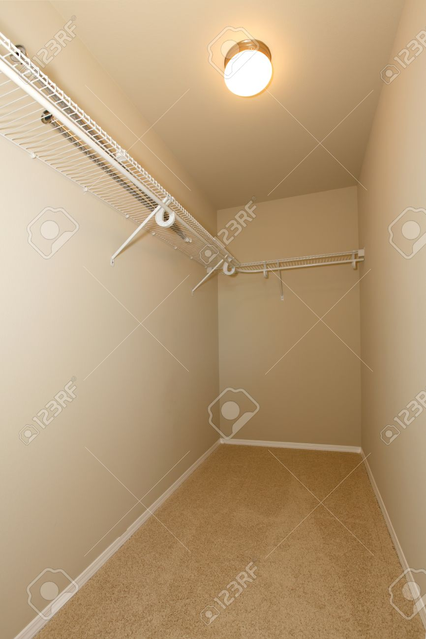 Empty walk-in closet with beige walls and ceiling Stock Photo - 25190276