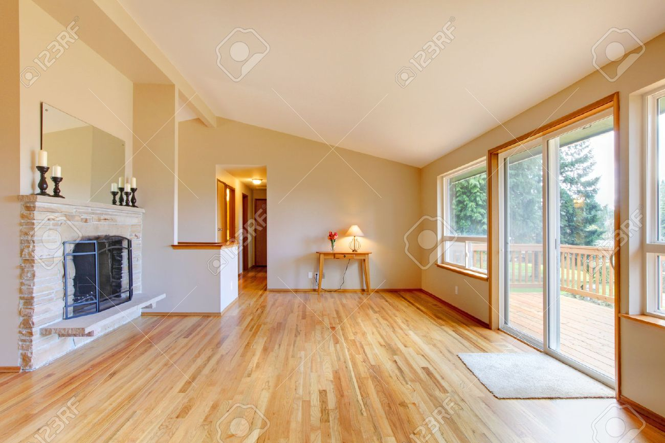 Empty Living Room With A Fireplace Hardwood Floor And Sliding