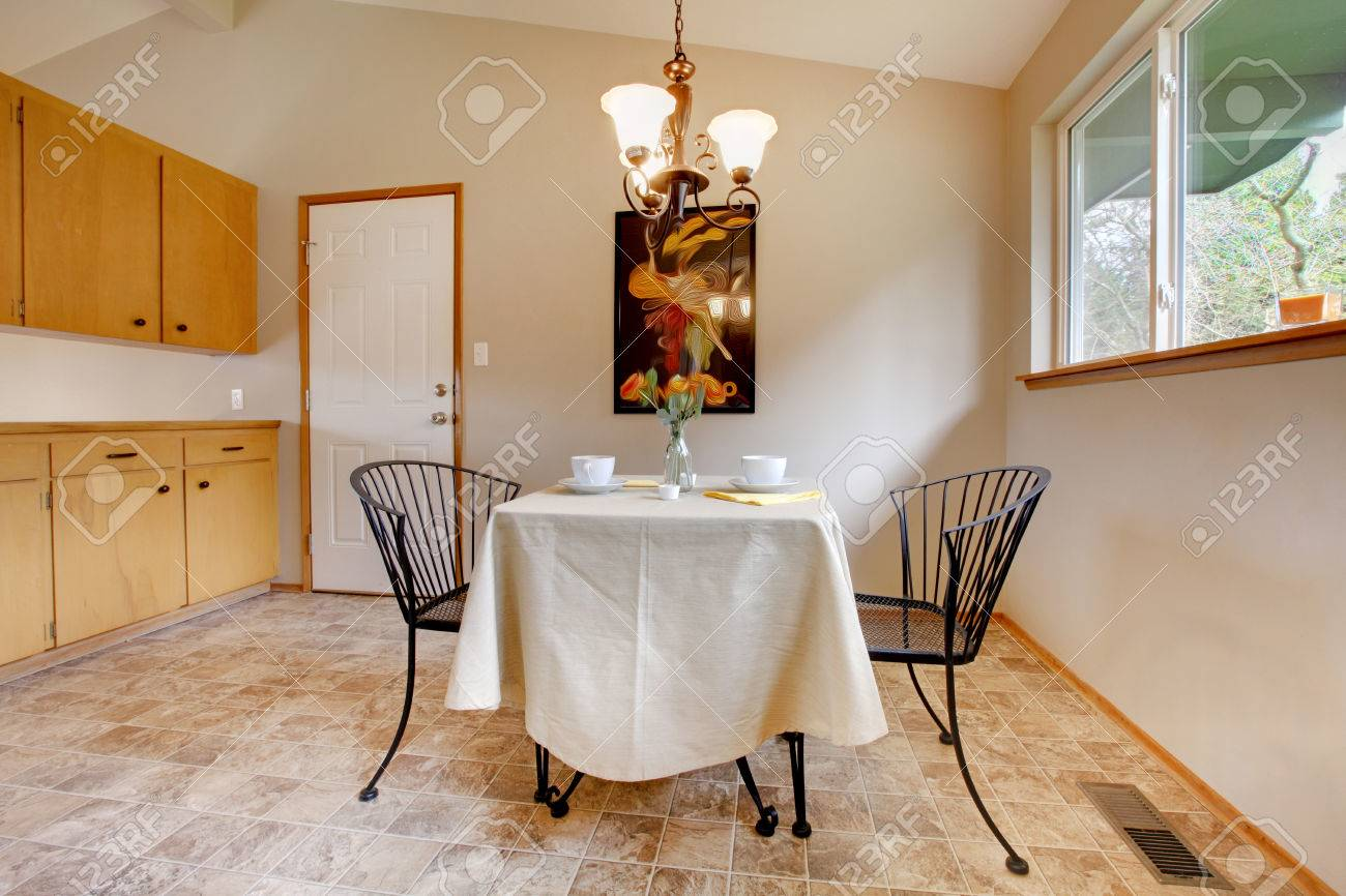 Metal Kitchen Table And Chairs Dining Room With Metal Kitchen Table Set And Tile Floor Stock