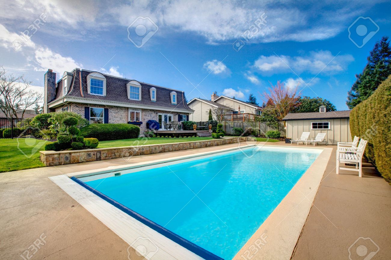 Big House With Swimming Pool two story stone facing house with back porch and big swimming