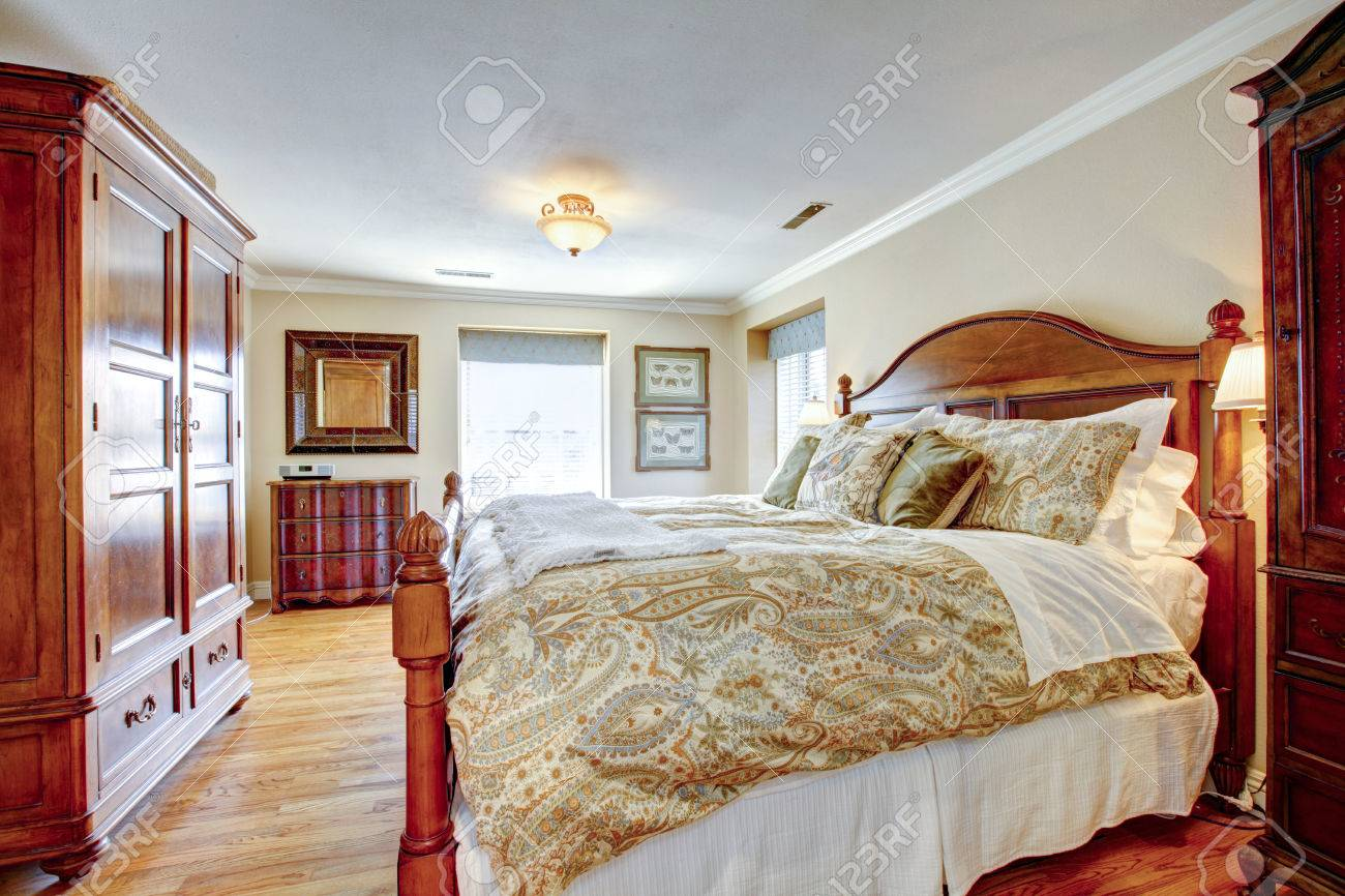 Large furnished bedroom with rustic furniture and hardwood floor Stock Photo - 25430337