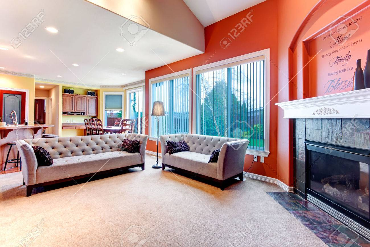 Great color combination. Orange walls make your living room..