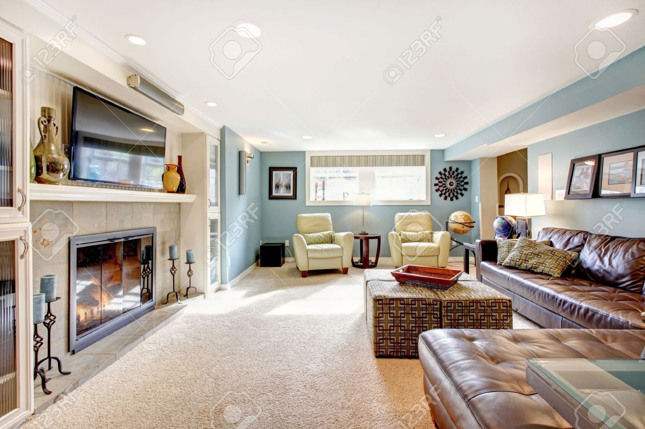 Light Blue Living Room With Leather Furniture Set, Beige Carpet Floor, Tv  And Fireplace Part 73