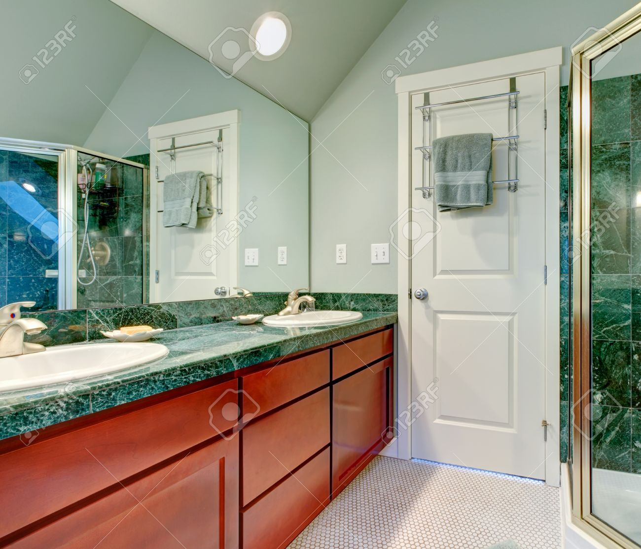 Bathroom Lighting Vaulted Ceiling light green bathroom with vaulted ceiling, tile floor and brown