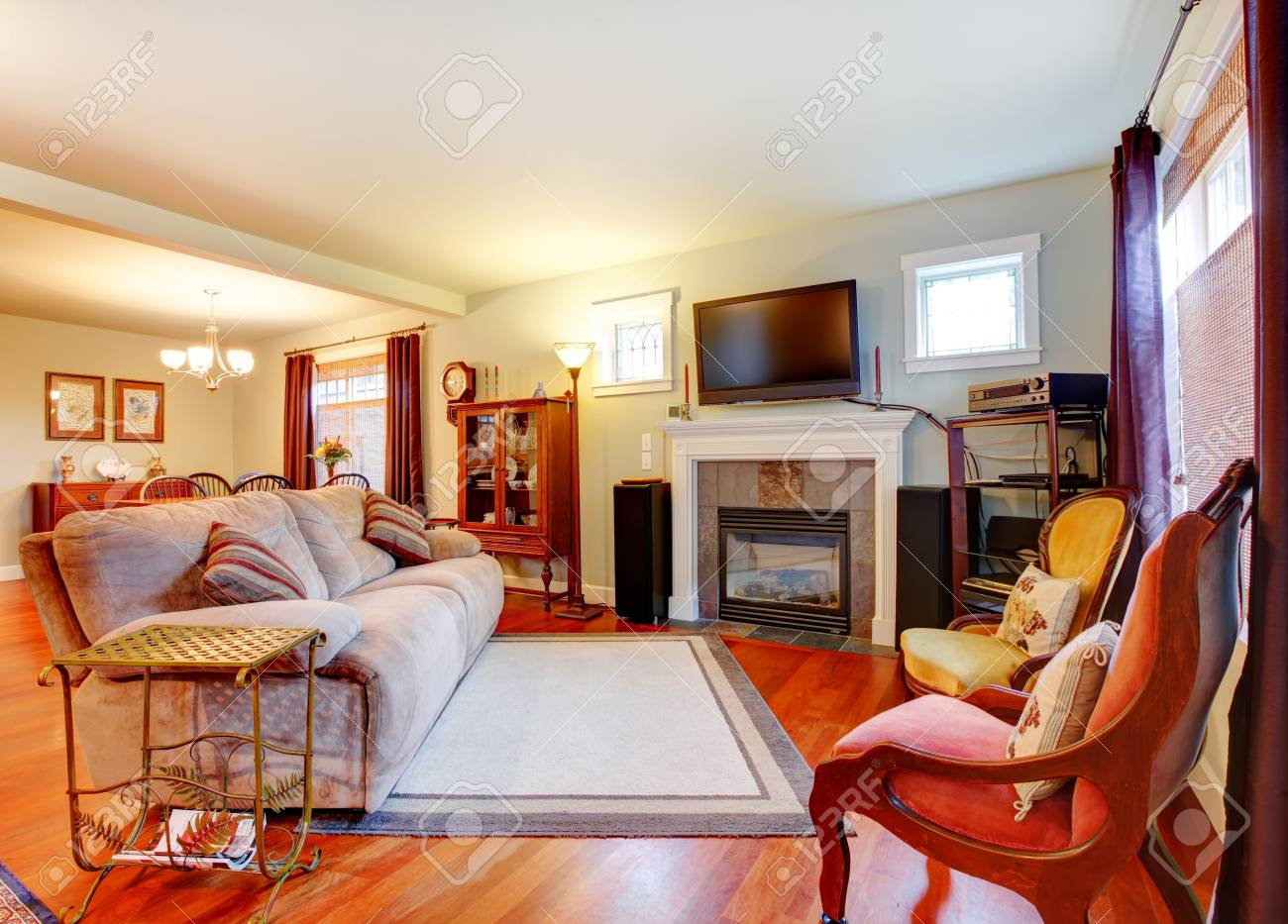 Furnished Living Room With Fireplace And Tv Open To Rustic Furnished