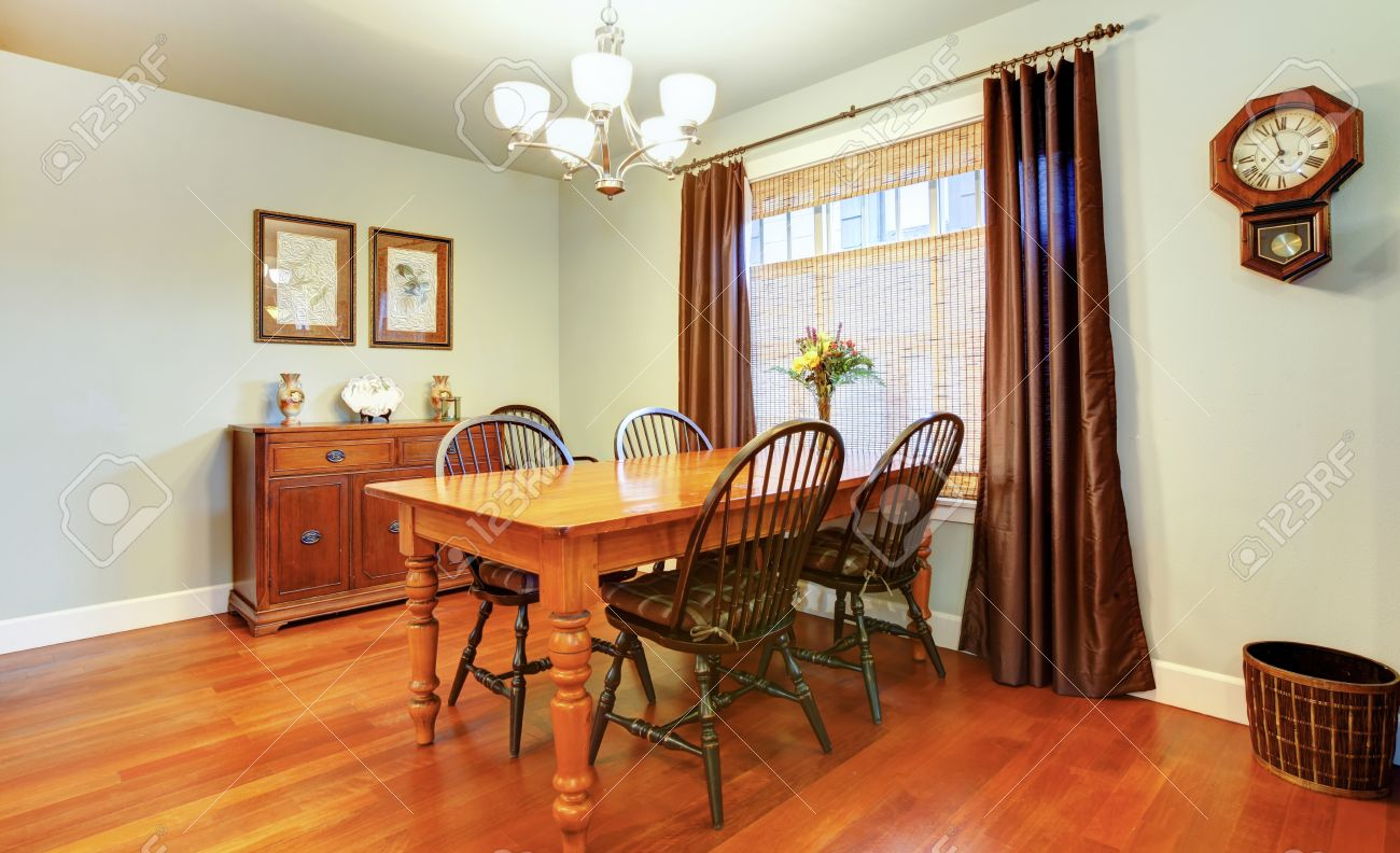 Light Tones Dining Room With Wood Dining Table Set, Rustic Wall Clock,  Wicker Basket
