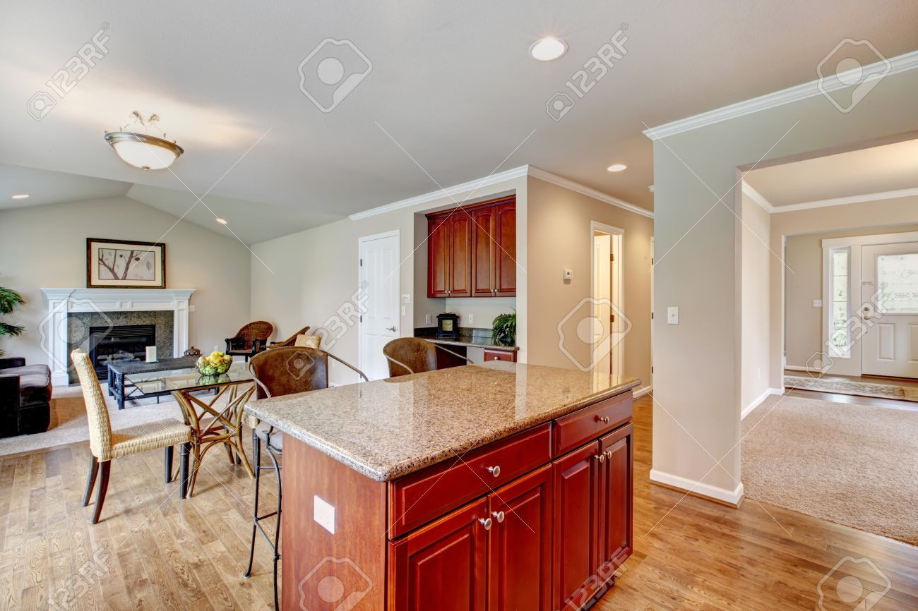Kitchen room with bright cherry wood cabinets, dining area with..