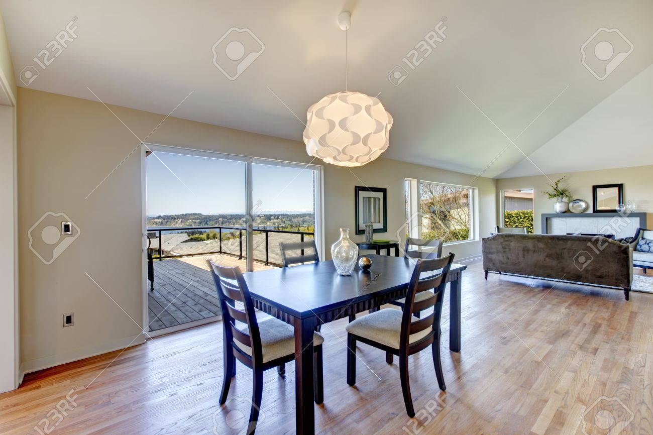 Open Plan Living Room And Dining Area Light Tone Vaulted Ceiling Perfectly Matches Hardwood Floor