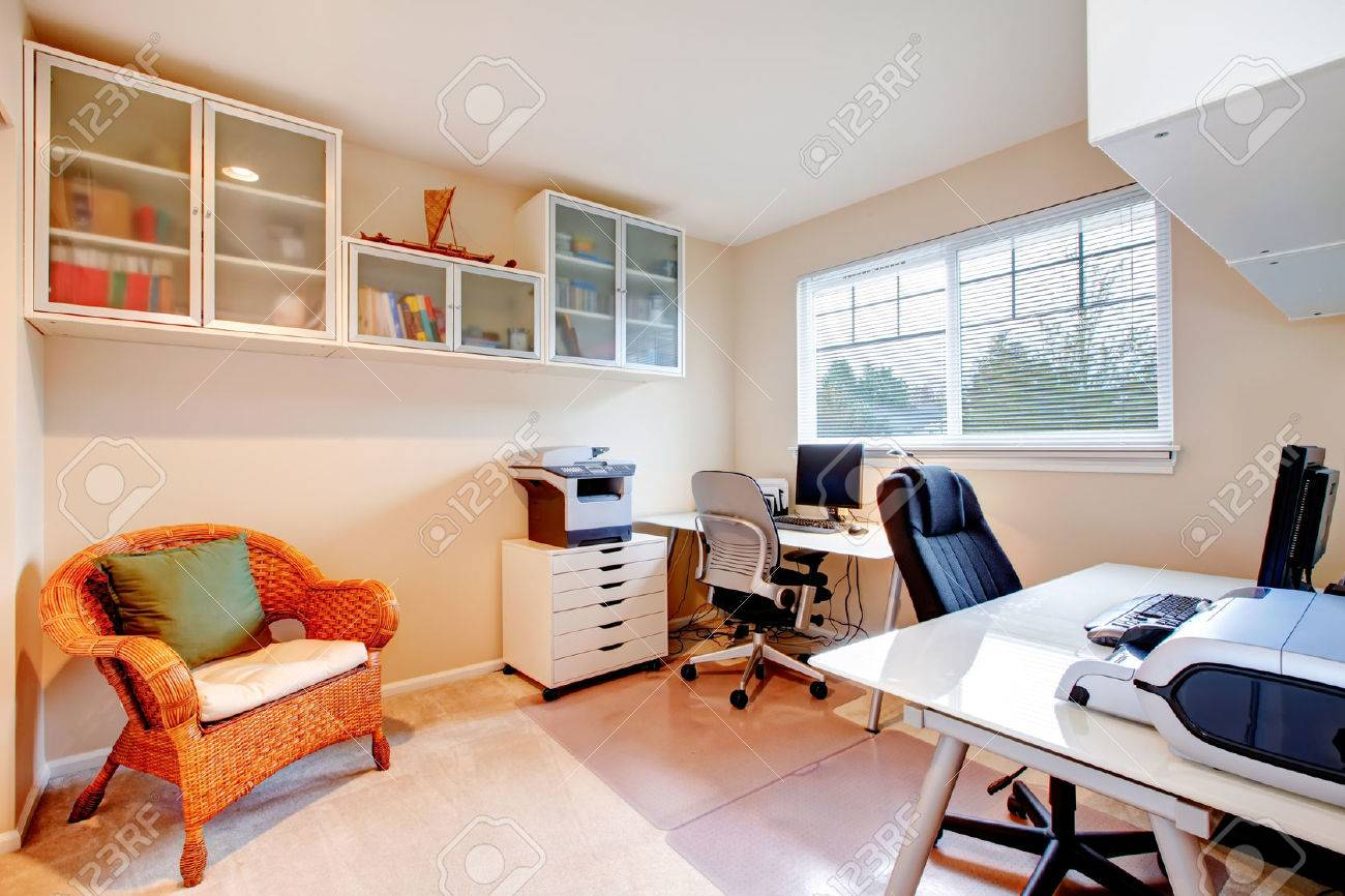 Furnished  office room with rustic wicker chair, glass door storage cabinets on the wall Stock Photo - 25651323