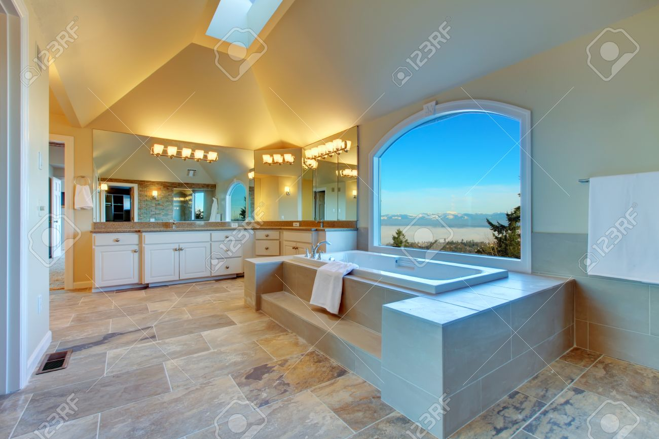 Large Luxury Bathroom With Concrete Floor, Cathedral Ceiling ...