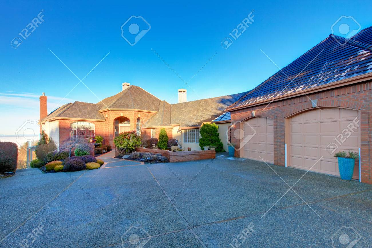 Large Luxury Brick House With Tile Roof And Excellent Curb Appeal. Big  Garage Attached With