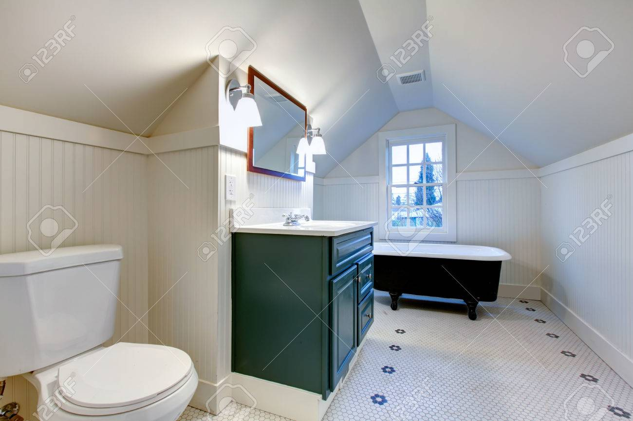 White Bathroom With Vaulted Ceiling. Antique Style Bath Tub,.. Stock ...