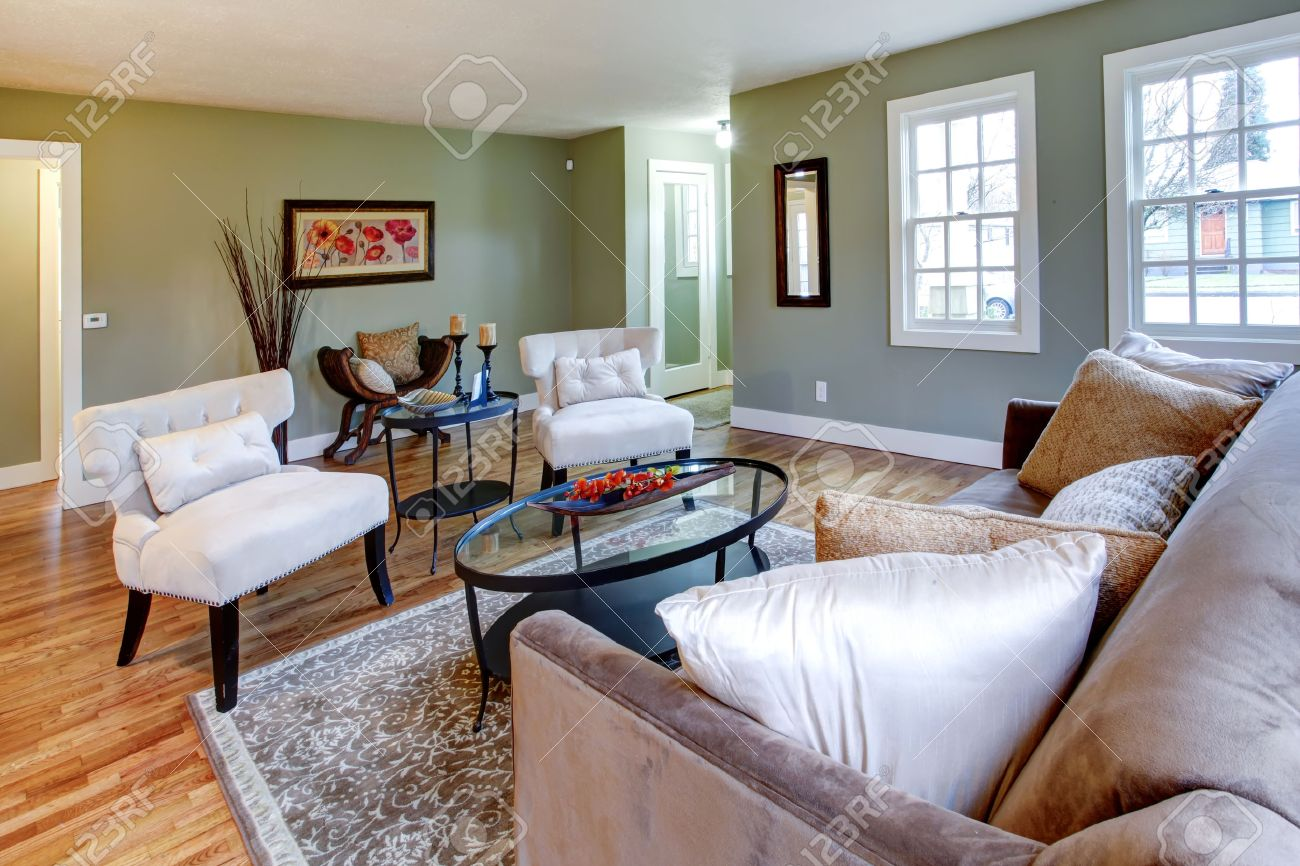 Aqua Living Room With Brown Rug, Sofa And White Classic Chairs ...