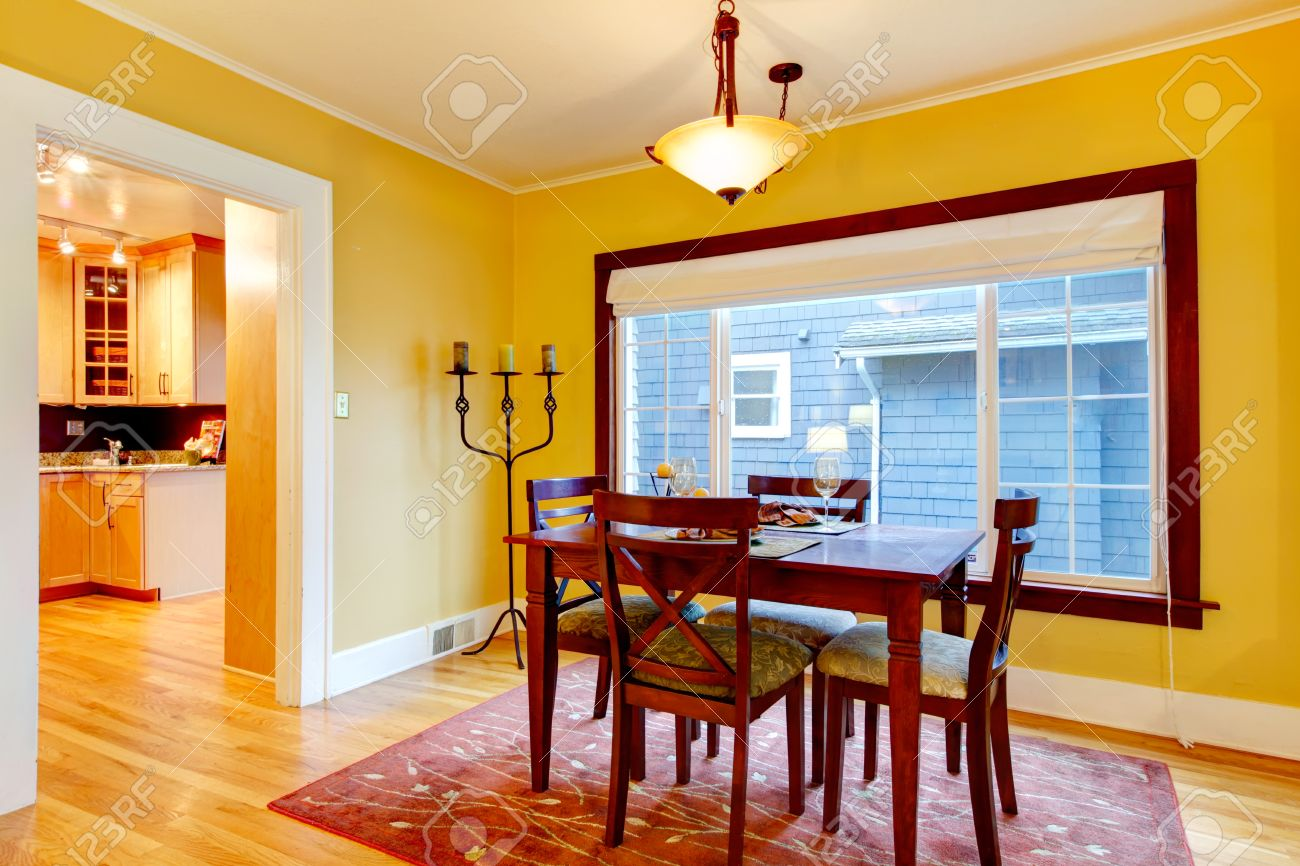 Elegant Dining Room With Big Window Yellow Wall Burgundy Wood Table Set And Matched