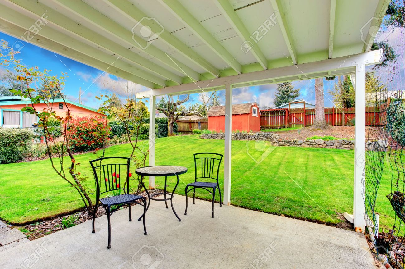 attached pergola with patio table set overlooking beautiful green
