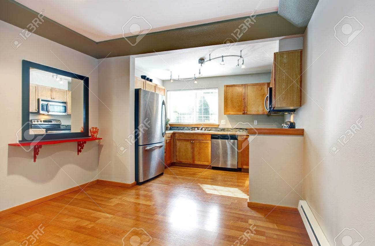 Small kitchen room with wooden storage cabinets, steel modern..