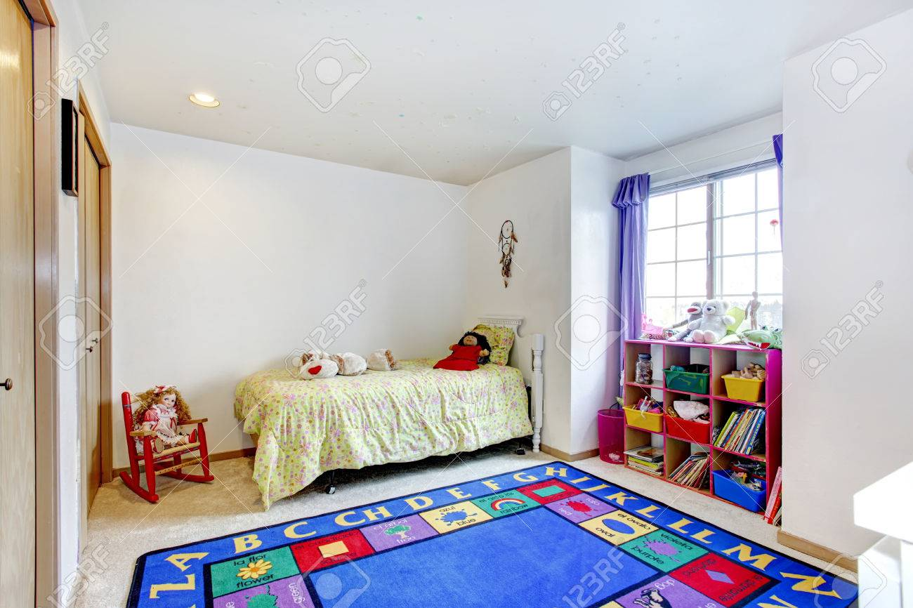Bright Young Adult Bedroom With Carpet Floor And Blue Rug, Rustic ...