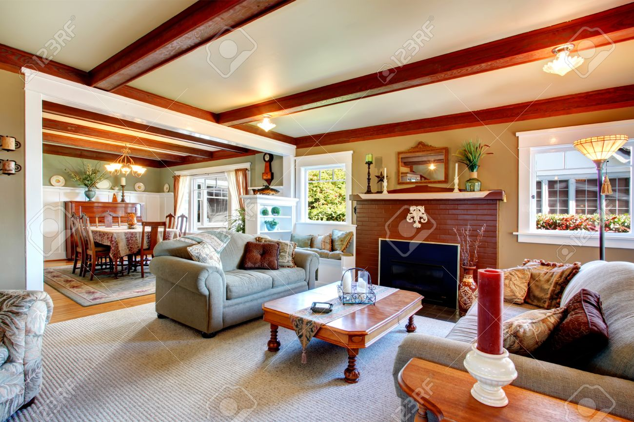 big living room with grey carpet floor ceiling beams stoned