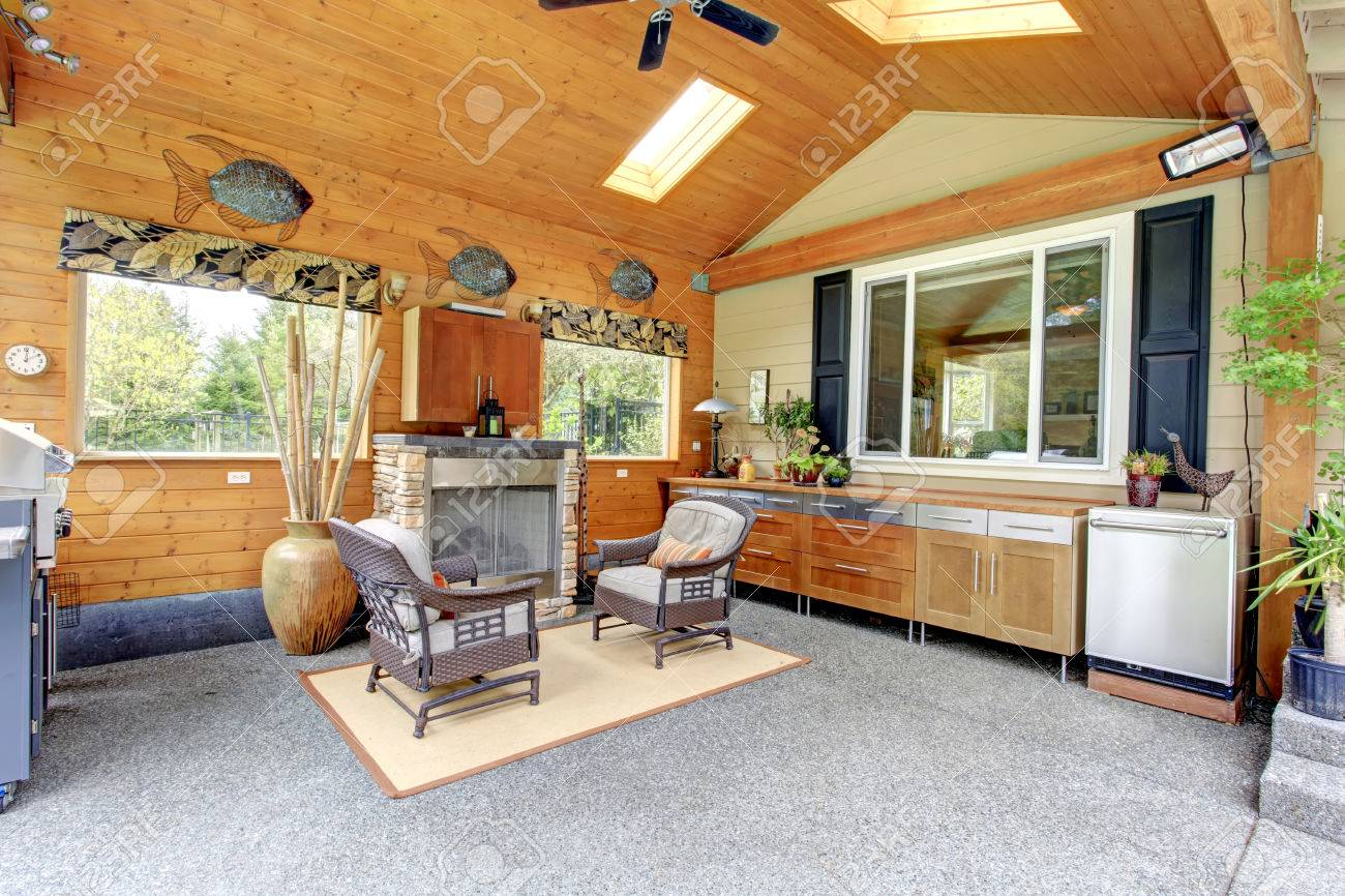 backyard cabin style patio area with concrete floor and wooden