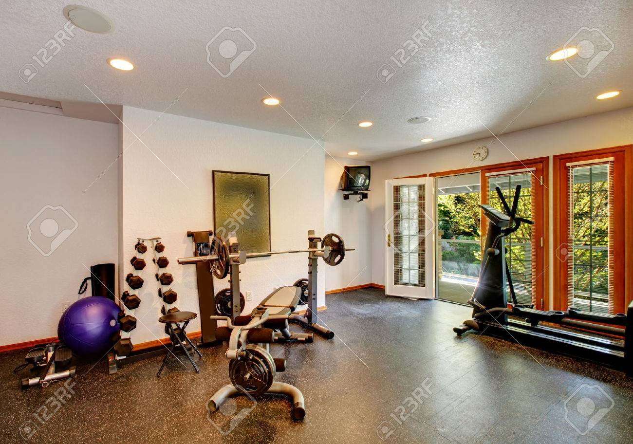 White and black home gym with different exercise equipments and