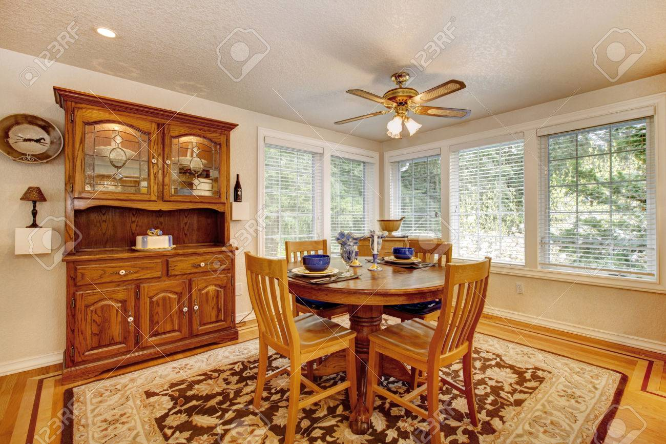 Bright Dining Room With Rustic Dining Table Set And Wooden Storage - Dining room storage cabinets