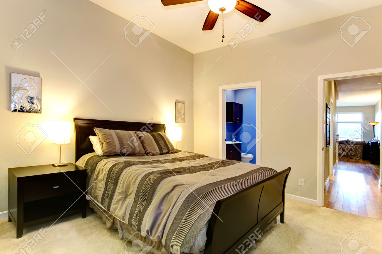 Soft Tones Master Bedroom With Carpet Floor Dark Brown Bed And Stock Photo Picture And Royalty Free Image Image 26038061