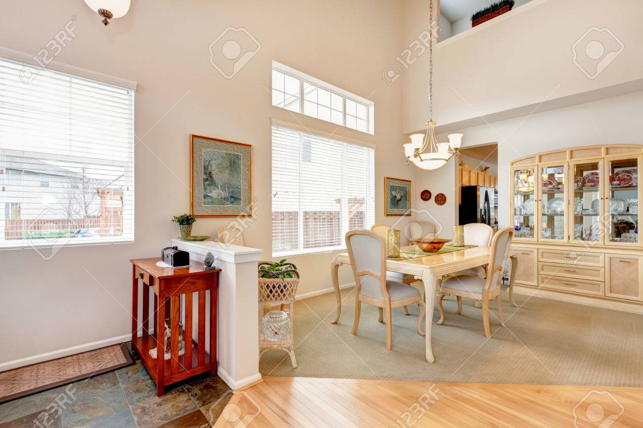 High Ceiling Dining Room With Light Wooden Table Set And Builtin - Dining room storage cabinets