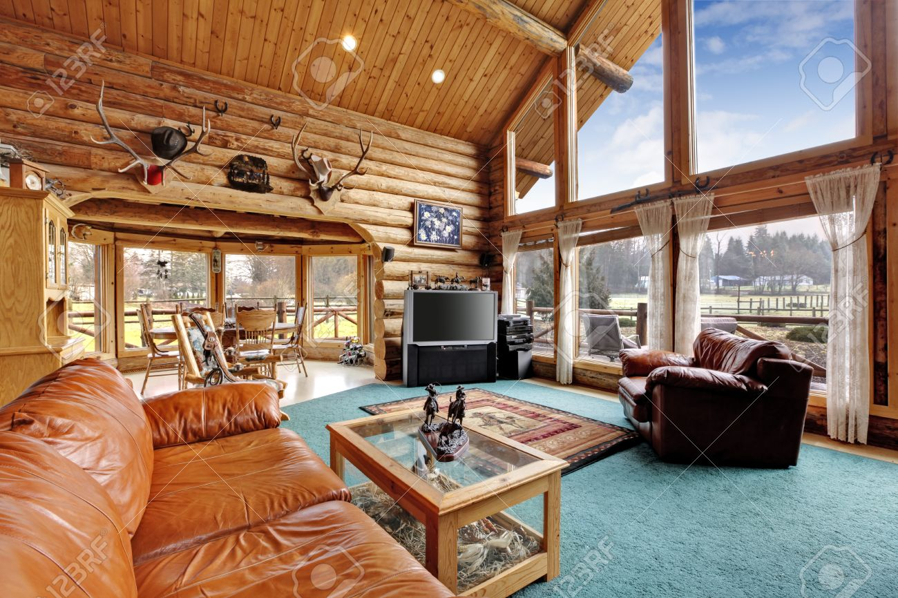 Large Beautiful Living Room In Log Cabin House With Leather Chair ...