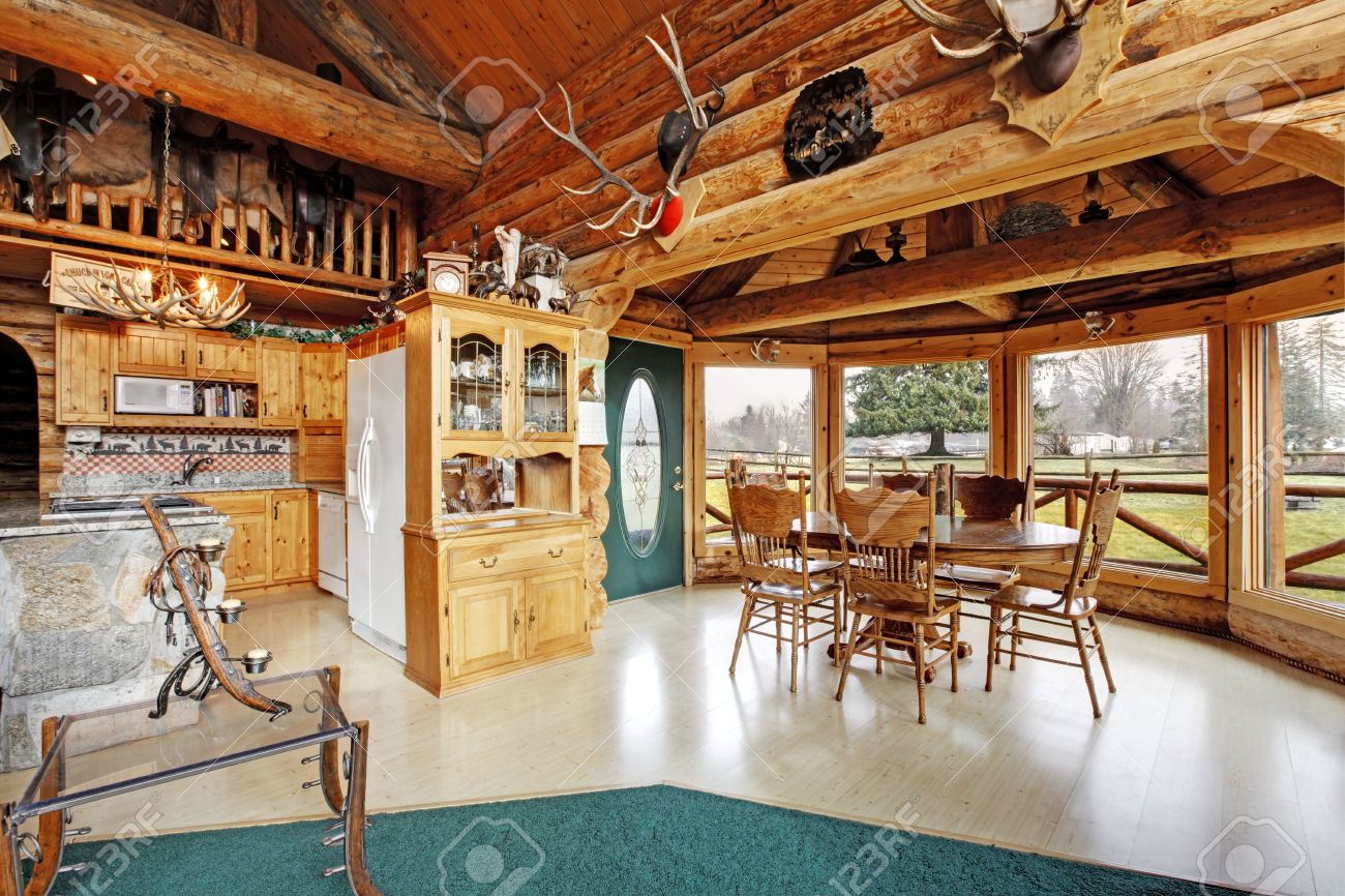 View Of Kitchen Room And Dining Area In Log Cabin House Furnished