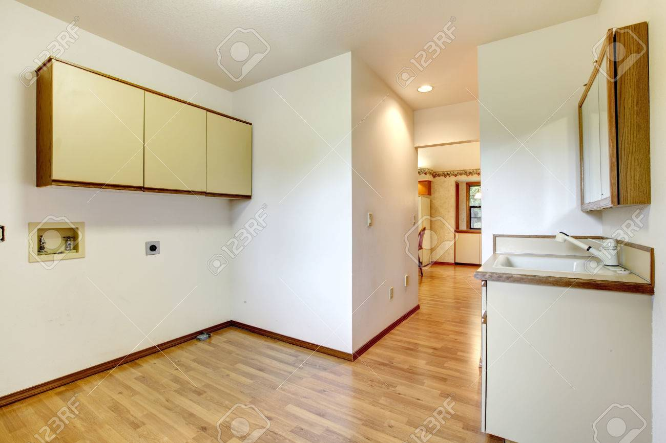 Empty room with a washbasin cabinet and wall cabinets. Stock Photo - 26300791