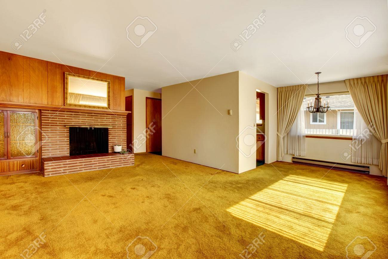 Empty living room with carpet - Empty Bright Living Room With Carpet Floor Brick Background Fireplace And Built In Cabinet