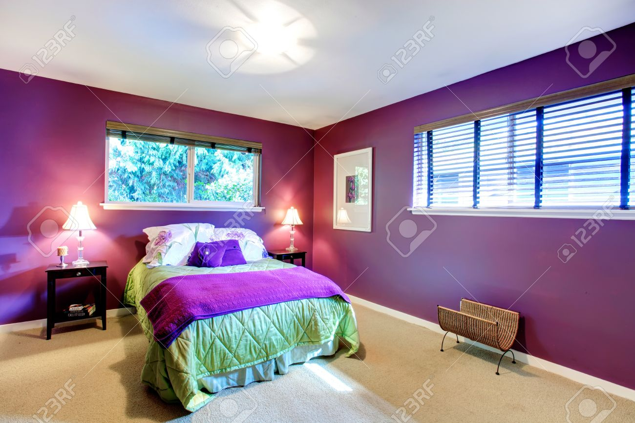 Elegant Bedroom With Beige Carpet Floor And Contrast Color Bright Purple Walls Green And Purple