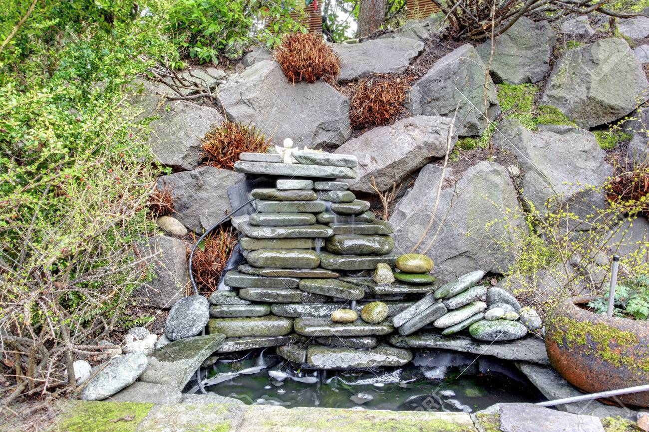 beautiful small fountain with rocks great landscaping idea for