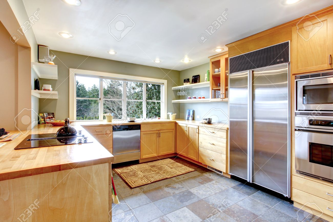 Kitchen With Concrete Floor And French Window Maple Cabinets