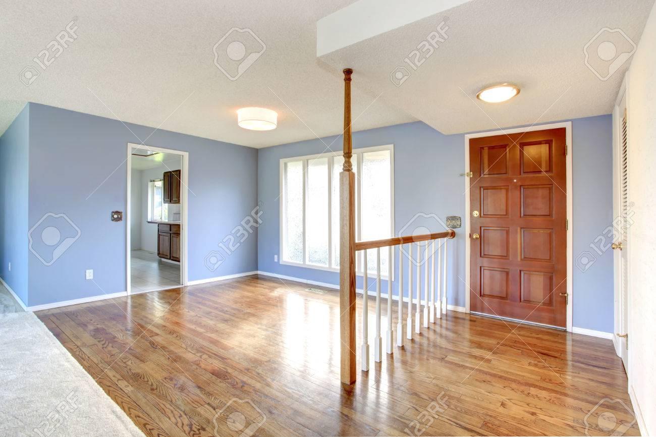 Lavender Wall Empty Hallway And Living Room With Hardwood Floor Big Window Stock Photo