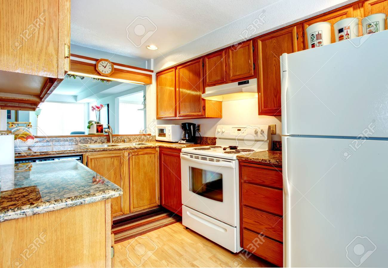 Uncategorized Orange Small Kitchen Appliances open wall small kitchen room with a hardwood floor wooden cabinets and white appliances stock